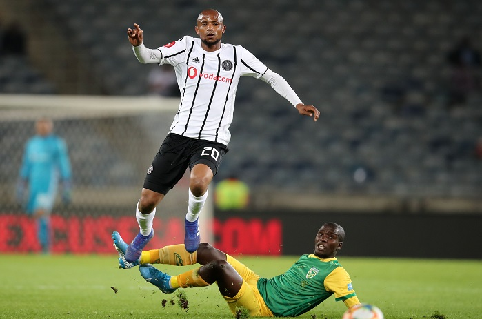 Xola Mlambo of Orlando Pirates tackled by Michael Gumede of Golden Arrows