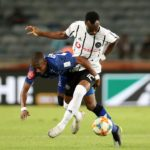 Justin Shonga of Orlando Pirates challenged by Bandile Shandu of Maritzburg United