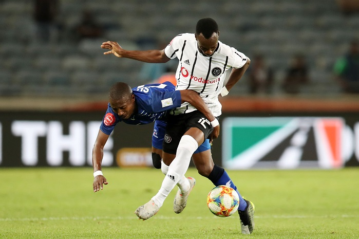 Justin Shonga of Orlando Pirates challenged by Bandile Shandu of Maritzburg United