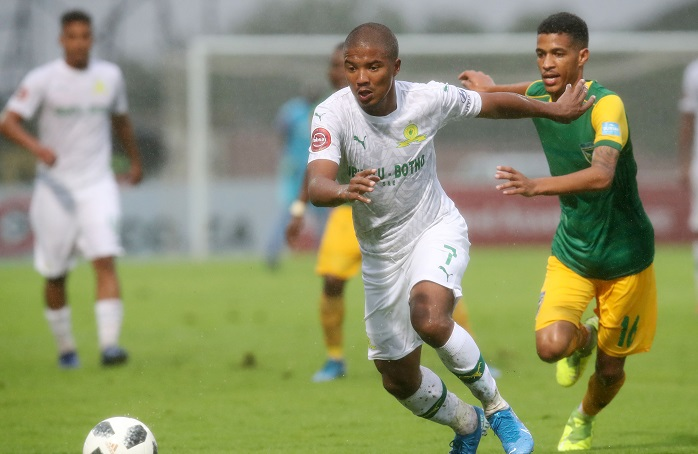 Lyle Lakay of Mamelodi Sundowns challenged by Seth Parusnath of Golden Arrows