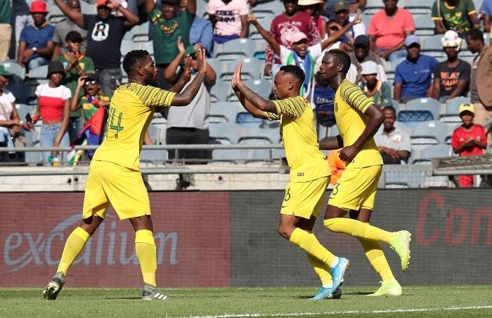 Lebogang Phiri celebrates his goal with teammate Thulani Hlatshwayo of Bafana Bafana
