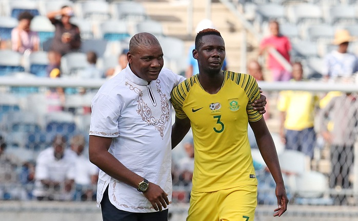Molefi Ntseki, coach of Bafana Bafana with defender Eric Mathoho