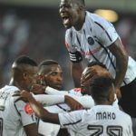 Kabelo Dlamini of Orlando Pirates celebrates his goal with teammates