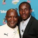 Pitso Mosimane, coach of Mamelodi Sundowns, with Rhulani Mokwena of Orlando Pirates d