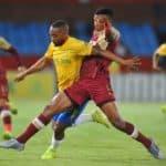 Sibusiso Mthethwa of Stellenbosch FC tackles Sibusiso Vilakazi of Mamelodi Sundowns