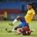 Nkanyiso Zungu of Stellenbosch FC tackles Themba Zwane of Mamelodi Sundowns