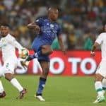 Judas Mosemaedi of Maritzburg United challenged by Motjeka Madisa of Mamelodi Sundowns