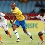 Mosa Lebusa of Mamelodi Sundowns challenged by Dominic Chungwa (l) and Salulani Phiri of Polokwane City