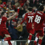 Liverpool players celebrate after Shrewsbury Town's Ro-Shaun Williams, scored an own goal during the FA Cup fourth round replay match at Anfield, Liverpool.