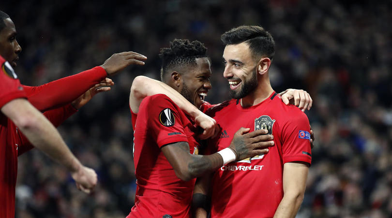 Manchester United's Bruno Fernandes celebrates scoring his sides first goal with teammates during the Europa League match at Old Trafford, Manchester.