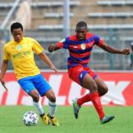 Ramphasane Chesane of Vaal University challenges Sphelele Mkhulise of Mamelodi Sundowns