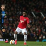 Club Brugge's Percy Tau chases down Manchester United midfielder Fred