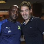 Pitso Mosimane, coach of Sundowns (L) and Rene Weiler, coach of Al Ahly (R) pose for photographs before the CAF Champions League quarter final second leg soccer match between Mamelodi Sundowns and Al Ahly at Lucas Moripe Stadium, South Africa