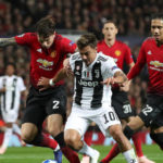 Manchester United's Victor Lindelof and Juventus' Paulo Dybala battle for the ball during the UEFA Champions League match at Old Trafford, Manchester.