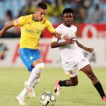 Gaston Sirino of Mamelodi Sundowns challenged by Lesedi Kapinga of Black Leopards