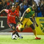 Siyabonga Dube of Lamontville Golden Arrows challenges Paseka Mako of Orlando Pirates
