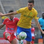 Mauricio Affonso of Mamelodi Sundowns tackled by Ayoub El Amloud of Wydad Athletic Club