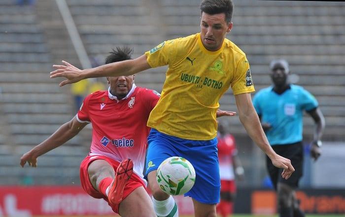 Mauricio Affonso of Mamelodi Sundowns tackled by Ayoub El Amloud of Wydad Athletic Club