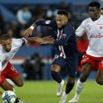 Neymar (C) of Paris Saint Germain in action against Yunis Abdelhamid (L) and Marshall Munetsi (R) of Reims
