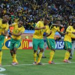Siphiwe Tshabalala of South Africa celebrate with teammates during the 2010 FIFA World Cup Group A football match between South Africa and Mexico at Soccer City, Johannesburg on 11 June 2010