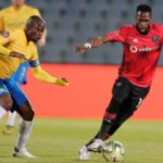Fortune Makaringe of Orlando Pirates challenged by Hlompho Kekana of Mamelodi Sundowns