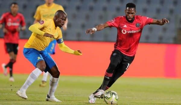 Fortune Makaringe of Orlando Pirates challenged by Hlompho Kekana of Mamelodi Sundowns