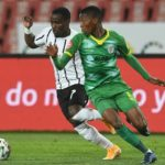 Gabadinho Mhango of Orlando Pirates challenges Bonginkosi Makume of Baroka FC