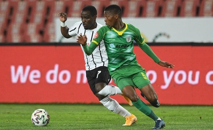 Gabadinho Mhango of Orlando Pirates challenges Bonginkosi Makume of Baroka FC