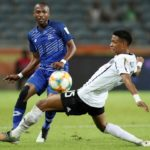 Bandile Shandu of Maritzburg United challenged by Vincent Pule of Orlando Pirates