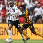 Xola Mlambo of Orlando Pirates challenged by Dumisani Zuma of Kaizer Chiefs