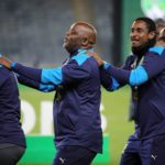 Rhulani Mokwena and Pitso Mosimane celebrate with the Sundowns backroom staff after lifting the Nedbank Cup