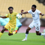 Percy Tau of South Africa challenged by Leonard Mulenga of Zambia during the international friendly match between South Africa and Zambia at Royal Bafokeng Stadium, Rustenburg, on 11 October 2020 ©Samuel Shivambu/BackpagePix