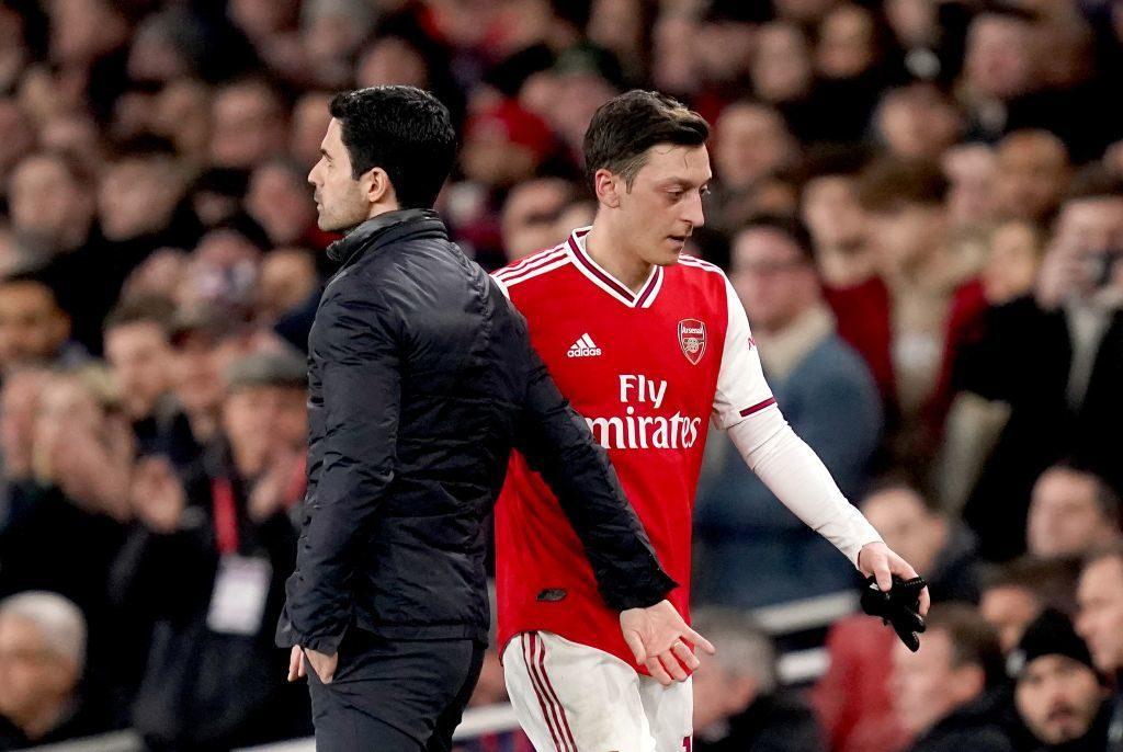 Arsenal coach Mikel Arteta and Mesut Ozil