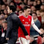 Arsenal coach Mikel Arteta and Mesut Ozil
