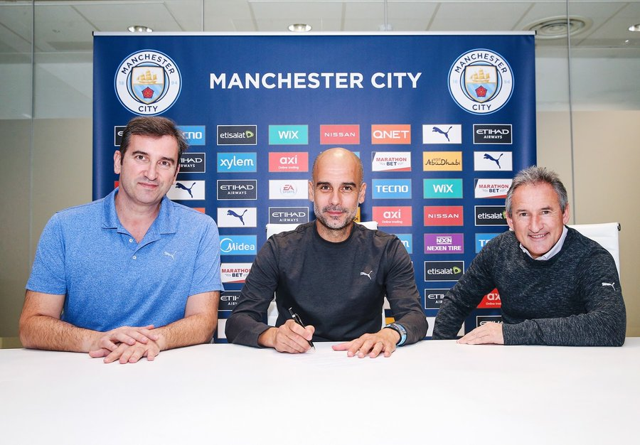 Pep Guardiola signs new two-year contract with Manchester City