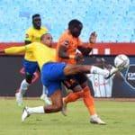 Gabadinho Mhango of Orlando Pirates challenged by Rivaldo Coetzee of Mamelodi Sundowns