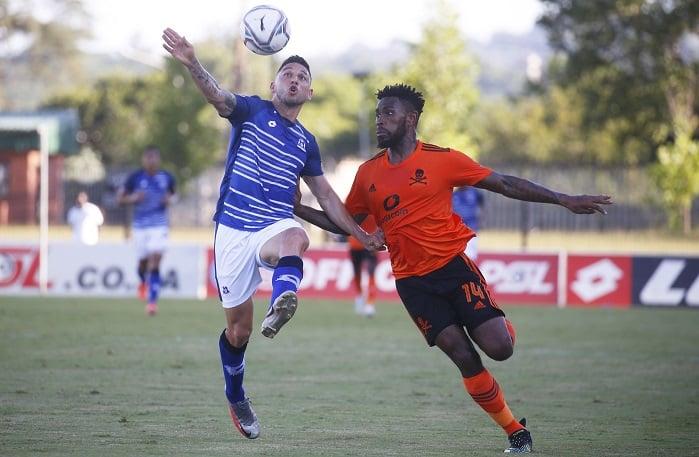 Jose Meza of Maritzburg United challenged by Thulani Hlatshwayo of Orlando Pirates