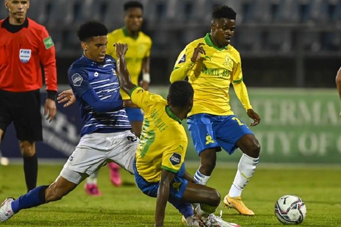 Rushine de Reuck of Maritzburg United steals the ball fromThemba Zwane of Mamelodi Sundowns FC