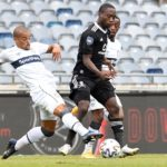 Ben Motshwari of Orlando Pirates challenged by Fagrie Lakay of Cape Town City
