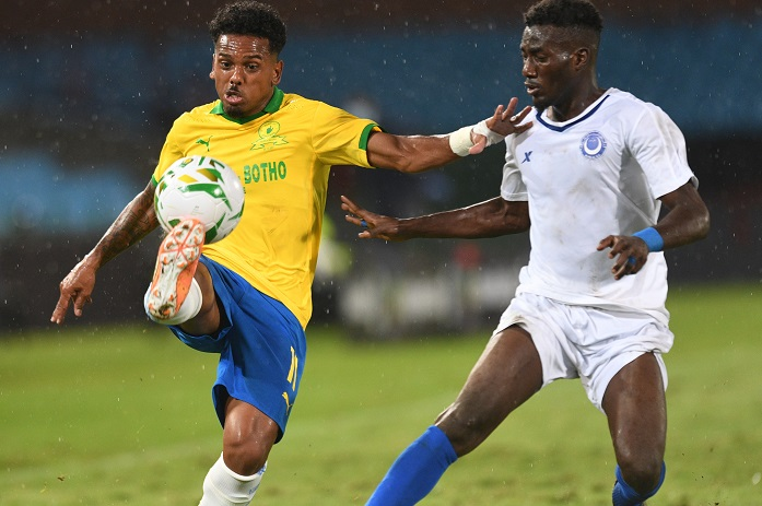 Kermit Erasmus of Mamelodi Sundowns challenged by Mohamed Saeed Ahmed of Al Hilal