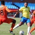 Andile Jali of Mamelodi Sundowns challenged by Nico Ngobe of Polokwane City