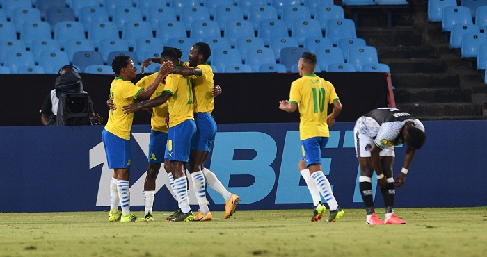 Lebohang Maboe of Mamelodi Sundowns celebrates goal with teammates during the 2021 CAF Champions League match between Downs and TP Mazembe