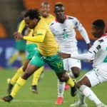 Percy Tau of South Africa challenged by Ismail Abdul Ganiu of Ghana