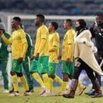 Helman Mkhalele, assistant coach of Bafana Bafana congratulates the players after victory over Uganda