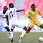 Lebohang Maboe of South Africa challenged by Augustine Kabaso Mulenga of Zambia