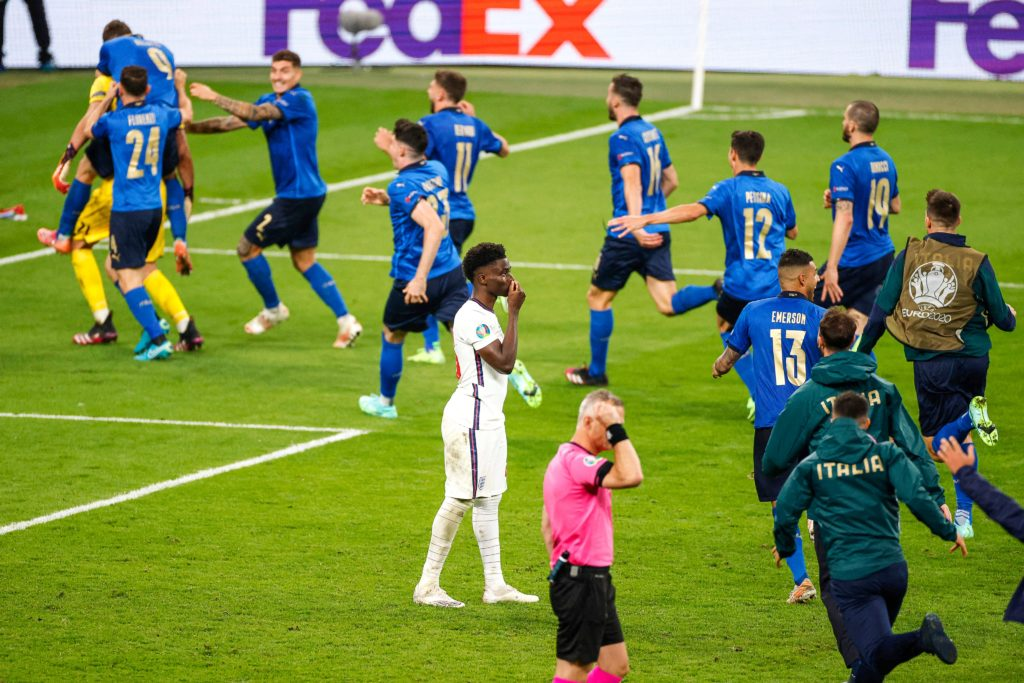 Italy celebrate their penalty shootout victory over England