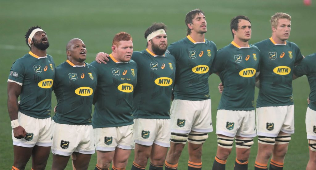 Siya Kolisi of South Africa (l) leads team as they sing national anthems during the Second Test of the 2021 British and Irish Lions Rugby Tour between South Africa and BI Lions at Cape Town Stadium on 31 July 2021 ©BackpagePix