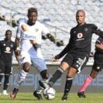 Goodman Mosele of Orlando Pirates challenged by Nathan Sinkala of Stellenbosch FC