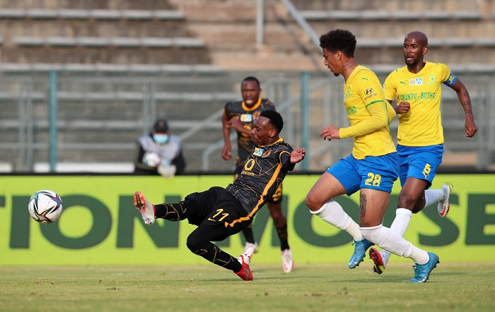 Khama Billiat of Kaizer Chiefs scores goal while challenged by Rushine De Reuck of Mamelodi Sundowns during the 2021 MTN8 Quarter Final