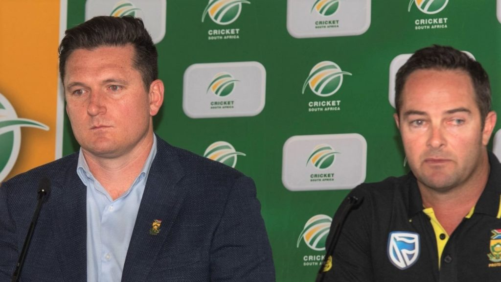 Enoch Nkwe(L), the South African Cricket assistant coach, Graeme Smith(C), Cricket South Africa interim director of cricket and former Test captain, and Mark Boucher(R), the South African Cricket coach, speak during a press conference at the Newlands Cricket grounds in Newlands, on December 14, 2019. (Photo by Brenton Geach / AFP) (Photo by BRENTON GEACH /AFP via Getty Images)